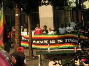 The crowd outside Zimbabwe House on Saturday afternoon