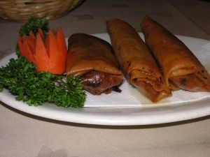 Tasty veggie spring rolls with carrot veggie sculptures